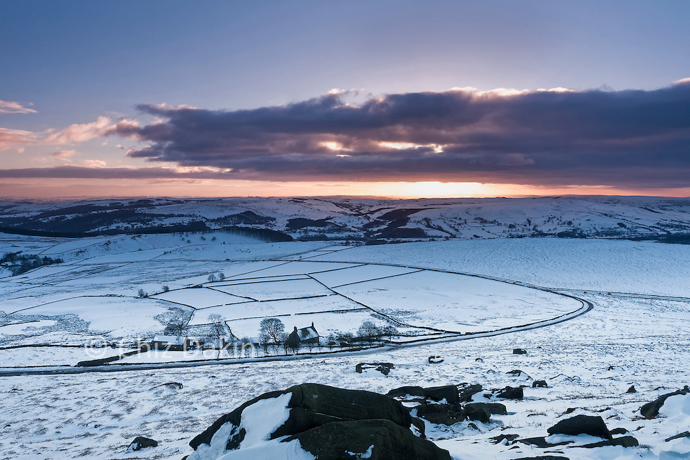 View down into Dale Bottom from Stanage Edge, late afternoon in winter snow