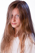 An individual child wearing a white t-shirt, with a neutral expression.