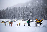 Teton County Search and Rescue personnel prepare to skin into the Coal Creek drainage Thursday morning to begin liiking for a missing snowboarder who was buried in an avalanche on Taylor Mountain the day before. Several agencies and more than two dozen people were involved in the search.