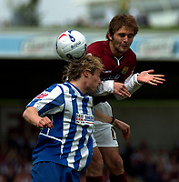 Photo: Ian Hebden.<br />Northampton Town v Chester City. Coca Cola League 2. 29/04/2006.<br />Chesters Ben Davies (L) wins a header from Northamptons David Rowson (L).