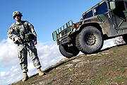 The US Military personnel serving under the Kosovo Force, which is a NATO-led international peacekeeping force in Kosovo, is seen patrolling Kosovo's southeastern border with Serbia on March 8, 2008. (Photo/Vudi Xhymshiti)