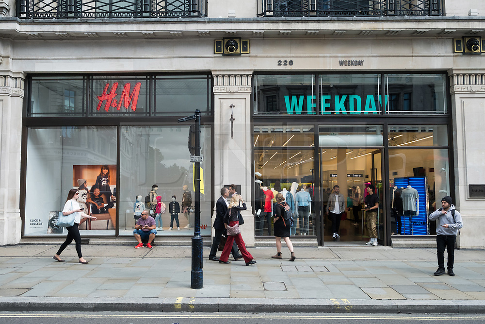 © Licensed to London News Pictures. 18/08/2017. London, UK. The new opening H&M group's first Weekday clothing store in Regent Street. is situated next to a H&M store. Weekday is know for its offerings and minimalist styles, with 27 stores throughout Europe. The store is next to the H&M Arket lifestyle store. Photo credit: Ray Tang/LNP