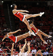 The Utah Utes cheerleaders perform during a timeout in the first half of an NCAA college basketball game against Arizona, Wednesday, Jan. 19, 2012, in Salt Lake City, Utah. (AP Photo/Colin E Braley)