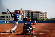 An exhibition game between Blue Stars players and a Chinese university team at a summer training camp run by Major League Baseball Wuxi, China, on 19 August, 2010.  Targeting teenagers between the ade of 12-15, the league hopes to use the camp to groom potential baseball talent in China and in the long term increase the popularity of the sport in the world's most populous country.