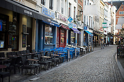 "© Licensed to London News Pictures. 23/11/2015. Brussels, Belgium. An empty restaurant at lunchtime on a deserted street in central Brussels where the city is currently on ""lockdown"" amid ""imminent threat"" of Paris-style bomb and gun attacks. Photo credit: Ben Cawthra/LNP"