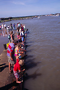 AJDME5 People crabbing high tide River blythe Walberswick Suffolk England