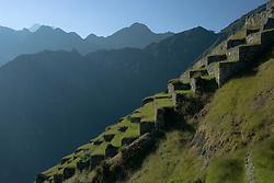 Machu Picchu, grass-covered steps in ruins of Inca city, Peru, South America