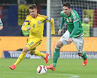 ROMANIA, Bucharest : Romania's Mihai Pintilii (L) and Northern Ireland's Kyle Lafferty (R) vie for the ball during the Euro 2016 Group F qualifying football match Romania vs Northern Ireland in Bucharest, Romania on November 14, 2014.