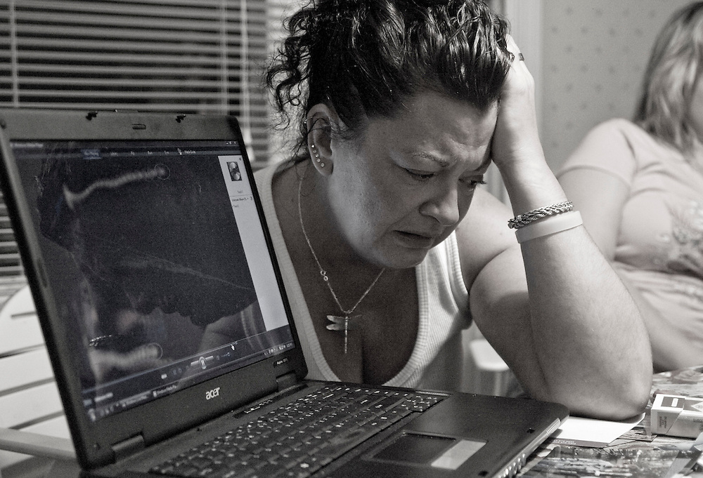 Sept. 14, 2009- Marie's daughter Tracie weeps as she listens to her deceased mother's voice recorded during an interview with a hospice care worker weeks earlier.