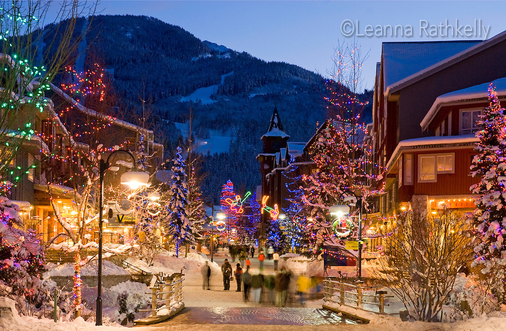 The lights of Christmas sparkle in Whistler Village on a winter evening.