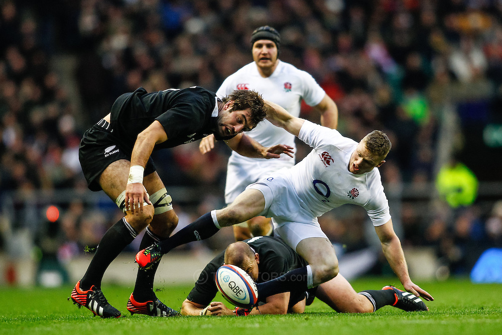 Picture by Andrew Tobin/SLIK images +44 7710 761829. 2nd December 2012. Chris Ashton of England squabbles for a loose ball with Tony Woodcock (on ground) and Sam Whitelock (L) of New Zealand during the QBE Internationals match between England and the New Zealand All Blacks at Twickenham Stadium, London, England. England won the game 38-21.