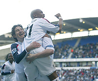 Photo: Aidan Ellis.<br /> Bolton Wanderers v Fulham. The Barclays Premiership. 11/02/2007.<br /> Bolton's El Hadji Diouf jumps on goal scorer Kevin Nolan with Andranik as well to celebrate the second goal