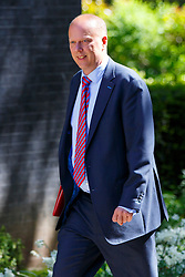 © Licensed to London News Pictures. 12/05/2015. LONDON, UK. Leader of the House of Commons Chris Grayling attending to the first Conservative cabinet meeting after the 2015 general election in Downing Street on Tuesday, 12 May 2015. Photo credit: Tolga Akmen/LNP