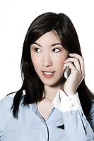 studio shot portrait of a beautiful southeast asian young woman phoning