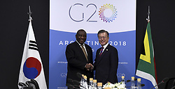 December 1, 2018 - Buenos Aires, Argentina - South Korean President Moon Jae-in, right, shakes hands with South African President Cyril Ramaphosa before a bilateral meeting on the sidelines of the G20 Summit meeting at the Costa Salguero Center December 1, 2018 in Buenos Aires, Argentina. (Credit Image: © G20 Argentina via ZUMA Wire)