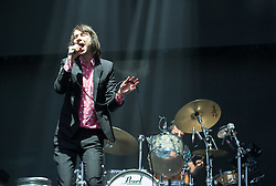 © Licensed to London News Pictures. 03/09/2016. Bristol, UK. BOBBY GILLESPIE, singer of PRIMAL SCREAM plays in the rain on the main stage at the Massive Attack music event on Bristol Downs. Photo credit : Simon Chapman/LNP