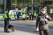 Canary Wharf security called police in response to political action from three members of the Extinction Rebellion environmental activist group who sprayed in a dark colour Barclays HQ building in Canary Wharf on Thursday, May 7, 2020. Barclays is the biggest European financier of fossil fuel companies. (Photo/ Vudi Xhymshiti)