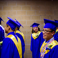 052215       Cable Hoover<br /> <br /> Cassiue Niiha glances around at her classmates before the class of 2015 graduation ceremony Friday at Zuni High School.