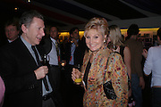 Ken Burgess and Angela Rippon, Opening night of Dralion. Cirque de Soleil's 20th anniversary. Royal Albert Hall. 6 jan 2005. ONE TIME USE ONLY - DO NOT ARCHIVE  © Copyright Photograph by Dafydd Jones 66 Stockwell Park Rd. London SW9 0DA Tel 020 7733 0108 www.dafjones.com