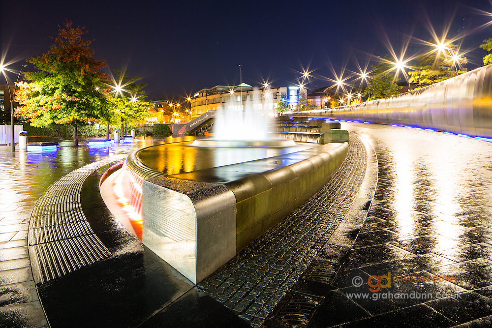 Sheffield's Sheaf Square water feature at night. Captured after heavy rainfall to enhance reflections. The Showroom Cinema can be seen in the distance. Urban landscape photography in South Yorkshire, England, UK. Autumn, October, 2014.
