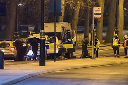 Victoria Embankment, London, January 19th 2017. Bomb disposal experts from the Royal Navy at Victoria Embankment to defuse and remove an unexploded bomb discovered,  between Hungerford Bridge and Westminster Bridge, near the Houses of Parliament, by engineers working in the River Thames. PICTURED: A Royal Navy bomb disposal officer, centre, dons protective clothing on Victoria Embankment