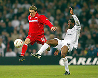 Photo: Scott Heavey.<br /> Middlesbrough v Bolton Wanderers. Carling Cup Final. 29/02/2004.<br /> Juninho (L) hurdles past the tackle from Jay_Jay Okocha