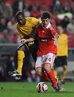20091217: LISBON, PORTUGAL - SL Benfica vs AEK Athens: Europa League 2009/2010 - Group Stage. In picture: Felipe Menezes (Benfica) and Tamandani Nsaliwa (AEK Athens FC). PHOTO: Alvaro Isidoro/CITYFILES