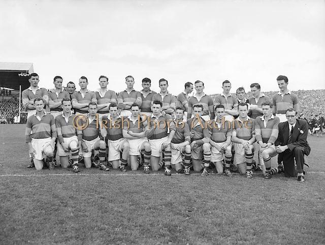 The Kerry team before the All Ireland Senior Gaelic Football Final Kerry v Dublin in Croke Park on the 25th September 1955. Kerry 00-12 Dublin 01-06.<br /> Back row from left, Ned Fitzgerald (sub), Micksie Palmer, Sean Murphy, Ned Roche, Jerome O'Shea, John Cronin, Michael Murphy, Tom Moriarty, Bobbie Buckley (sub), Tadgh Lyne, Jim Brosnan, John Joe Sheehan.<br /> Front row from left, Gerald O'Sullivan (sub), Colm Kennelly (sub), Denis O'Shea, Johnny Culloty, Paudie Sheehy, John Dowling (captain), Garry Mahony, Donal O'Neill (sub), Tom Costello, Dermot Dillon )sub), Dan McAuliffe (sub), Tadgh Crowley, Kerry Co Secretary,