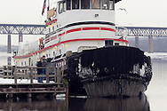 Newburgh, New York - A couple and a young boy stand on a dock to get a look at the Lyman, an ocean-going twin screw diesel powered steel tugboat, on the Hudson River just south of the Newburgh-Beacon Bridge on Feb. 20, 2007.