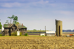 The Gebhardt farm in rural Shirley Illinois.  The farm is still active but the house is uninhabitable, vacant and ready to fall in.