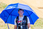 Poznan, POLAND, Saturday, 22/06/2019, GBR M1X, Tom BARRAS, walking with his umbrella,<br /> FISA World Rowing Cup II, Malta Lake Course, © Peter SPURRIER/Intersport Images,<br /> <br /> 13:28:25