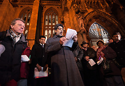 "© Licensed to London News Pictures. 17/11/2015. Bristol, UK.  Vigil for the victims of the Paris terrorist attacks at Bristol Cathedral.  Bristol's elected Mayor George Ferguson (left in red trousers) joins Religious and community leaders including Arif Khan (centre) chair of the Council of Mosques. The Muslim community in Bristol organised a candle-lit vigil for all faiths and backgrounds at Bristol Cathedral to show solidarity with the victims of the Paris attacks which are claimed by IS (Islamic State).  The management and Imaam's of Bristol's Easton Jamia Masjid, Bristol's biggest mosque, released a statement saying they have been shocked and saddened by the attacks on innocent people in France. ""We strongly condemn the terrorist atrocities in France, these sickening crimes are an attack against all of humanity.  As a local Muslim place of worship we send our condolences from our local community and congregation to the people of France.  During this very dark hour they will see compassion and solidarity from around the world"".  Photo credit : Simon Chapman/LNP"