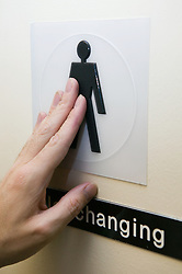 Raised symbol on the door of a male toilet to assist visually impaired people read the sign,