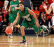 CHARLOTTESVILLE, VA- NOVEMBER 26:  Keifer Sykes #24 of the Green Bay Phoenix handles the ball during the game on November 26, 2011 at the John Paul Jones Arena in Charlottesville, Virginia. Virginia defeated Green Bay 68-42. (Photo by Andrew Shurtleff/Getty Images) *** Local Caption *** Keifer Sykes