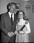 Pepsi Personality Girl, Swords.   (J64)..1975..13.07.1975..07.13.1975..13th July 1975..At Fingallian's GAA club, Ms Deirdre Murphy of St Columbas Road,Swords was selected as Miss Pepsi Personality Girl for the Swords district. Her selection was made at The Gala Marquee Dance in the club. the event was sponsored by Cantrell & Cochrane. The Dublin final will be held later this year...Picture shows Ms Deirdre Murphy being congratulated by Mr Bill Cashe, Area Manager, C & C, on her success in winning the Swords final of the Miss Pepsi Personality Girl contest