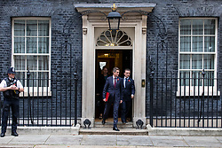 © Licensed to London News Pictures. 06/11/2018. London, UK. Defence Secretary Gavin Williamson (L) and Secretary of State for Wales Alun Cairns (R) leave 10 Downing Street after the Cabinet meeting. Photo credit: Rob Pinney/LNP