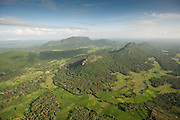 Aerial view looking North over the island from a point approximately South of Dambulla. Looking down over paddy fields and forest covered mountain ridges.
