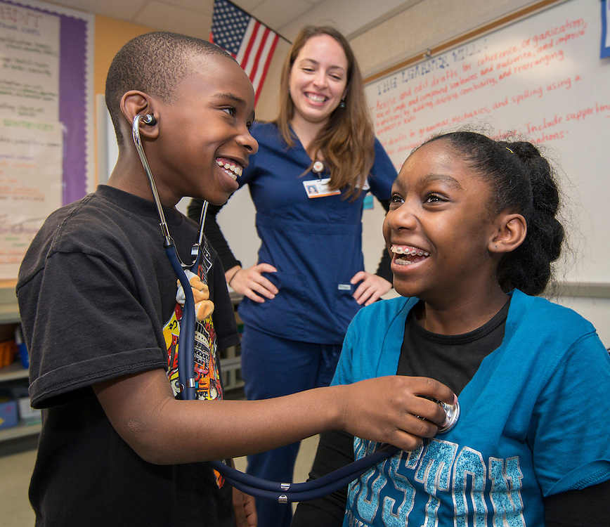 Students learn about health science from nurses at the University of Texas Health Science Center School of Nursing during Career Day at Foster Elementary School, March 14, 2014.