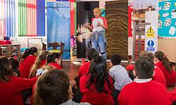 Ahead of the construction of the HS2 railway line, actors from ARC Theatre do a presentation on the dangers of construction sites to junior school children from year six at Maple Cross Junior School. Maple Cross Junior School, Maple Cross, Herts, February 20 2018.