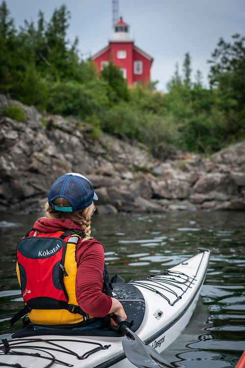 Kayaking near the Marquette Lighthouse on Lake Superior at the Lower Harbor of Marquette, Michigan.
