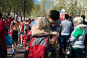 Competitors in the 2014 London Marathon. Runners with their medals and goody bags at the finnish area. London, UK.