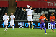 Jack Cork of Swansea city (c) in action. EFL Cup. 3rd round match, Swansea city v Manchester city at the Liberty Stadium in Swansea, South Wales on Wednesday 21st September 2016.<br /> pic by  Andrew Orchard, Andrew Orchard sports photography.