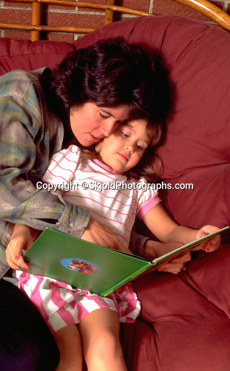 Mom reading story with daughter age 30 and 4.  WesternSprings Illinois USA