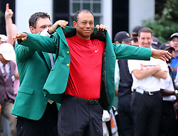 Last year's champion Patrick Reed presents Tiger Woods with his fifth green jacket after he won the Masters at Augusta National Golf Club on Sunday, April 14, 2019, in Augusta, GA, USA. Photo byCurtis Compton/Atlanta Journal-Constitution/TNS/ABACAPRESS.COM