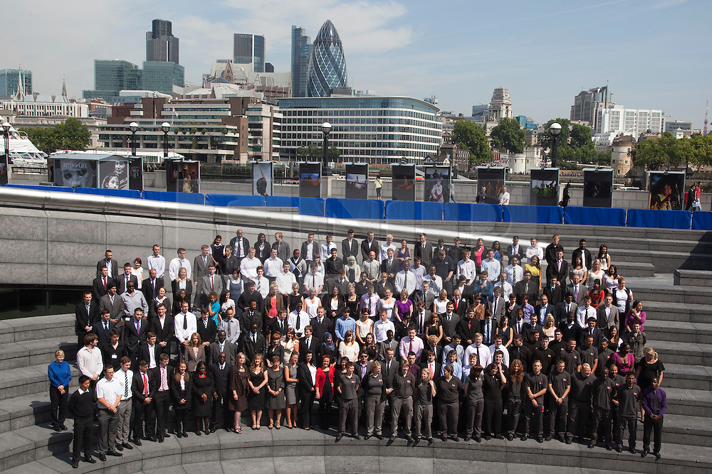 © licensed to London News Pictures. London, UK  05/07/2011. Young apprentices in the Scoop. Mayor of London Boris Johnson was joined by more than 150 apprentices and employers to celebrate beating his target of creating 20,000 apprenticeship opportunities in the capital. Working in partnership with the National Apprenticeship Service (NAS), the Mayor's campaign has seen a total of 28,120 people finding places on schemes with companies across a wide range of the capital's business sectors. The 20,000 target has been smashed three months early and by almost 50 per cent. Please see special instructions for usage rates. Photo credit should read Bettina Strenske/LNP