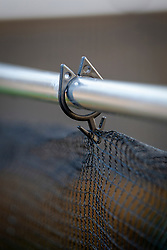 Detail of clip a used to secure netting on frame