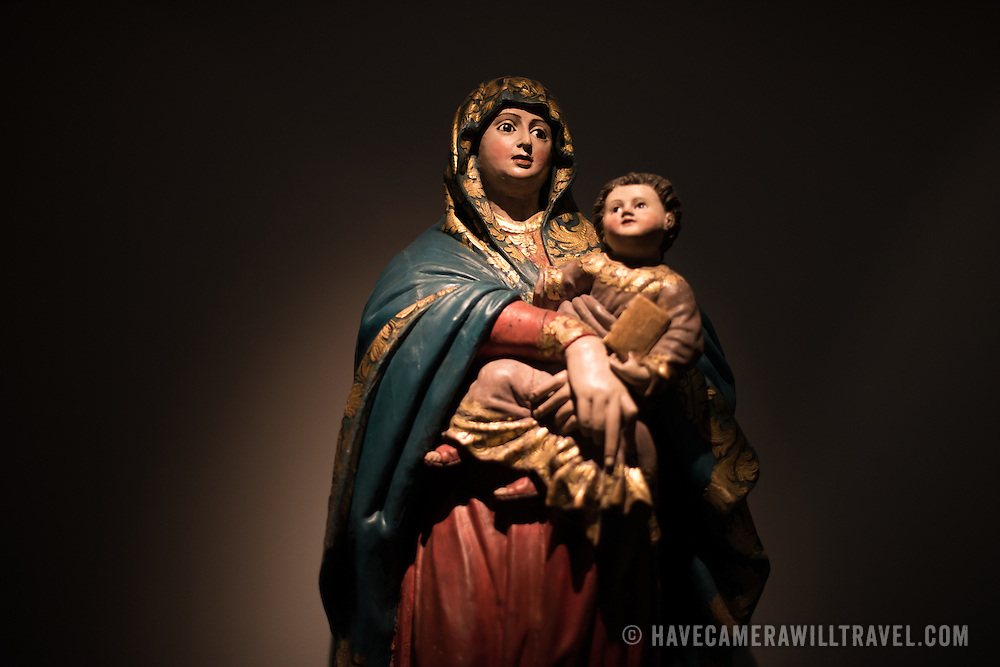 A 17th century guilded wooden statue of Madonna del Popolo. The Museu de São Roque is a museum attached to the the Igreja de Sao Roque to display various historical religious artefacts from the church. The 16th century Igreja de São Roque was one of the earliest Jesuit churches in Christendom and features a series of ornately decorated Baroque chapels.