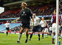 Photograph: Scott Heavey.<br />Aston Villa v Blackburn Rovers. FA Baclaycard Premiership. 05/10/2003.<br />Jussi Jaaskelainen shouts at the linesman after saving Juan Angel's penalty kick