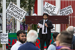 London, UK. 12th September, 2021. Saif Osmani, artist and designer, addresses local residents and supporters of the Save Brick Lane campaign in Altab Ali Park before a funeral procession along Brick Lane organised in protest against the ongoing gentrification of Shoreditch. Campaigners are protesting in particular against plans to develop the Truman Brewery into a shopping centre and 5-storey office building. Tower Hamlets experienced more gentrification than any other London borough between 2010-2016.