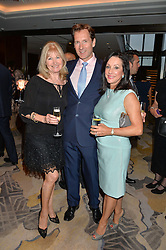 Left to right, DEBBIE MOORE, HAMISH SCOTT and LYN SCHLESINGER at a party to celebrate Jack Petchey's 90th birthday in association with the Stroke Association held at the Shangri-La Hotel, Level 34, The Shard, London on 13th July 2015.